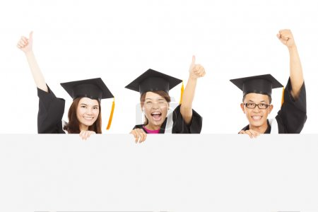 cheerful young graduate students raise hands